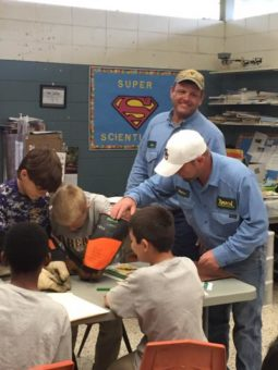 linemen in classroom teaching children about electrical safety