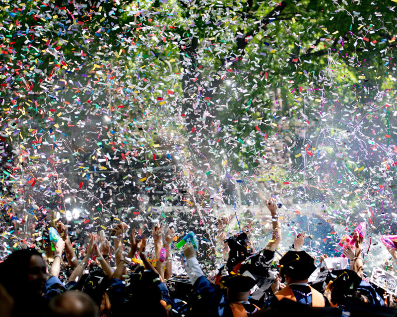 graduation students with confetti in air