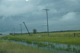power lines along road during storm