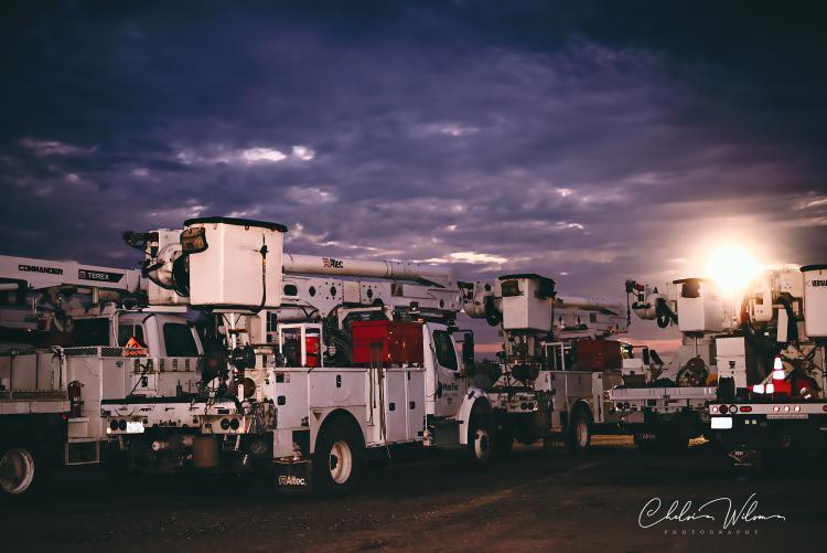 bucket trucks outside at night
