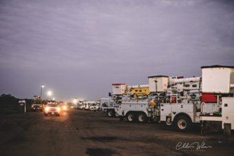 bucket trucks lined up outside