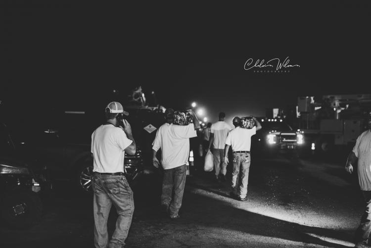 linemen walking outside